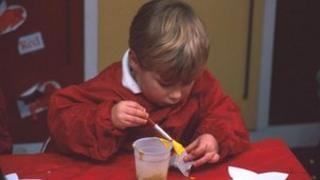 Boy playing in a nursery