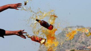 Pakistani Frontier Corps (FC) personal brake liquor bottles in a ceremony in the Shahkas area of the Jamrud Khyber Agency, one of the Federally Administered Tribal Areas, on 26 June 2013. Officials destroyed the contraband as part of International Anti-drug Day.