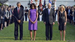 US President Barack Obama, First Lady Michelle Obama, Vice-President Joe Biden and Jill Biden observe a moment of silence to mark the 12th anniversary of the 9/11 attacks on the South Lawn of the White House in Washington, DC, on 11 September 2013