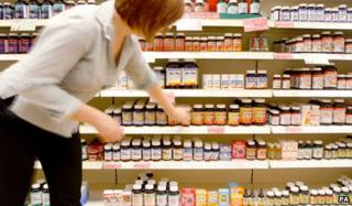 Woman buys health supplements in shop