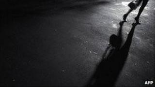 Woman walking on dark street