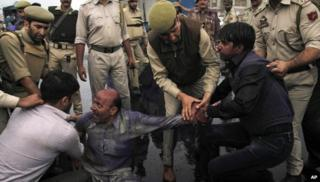 Indian policemen detain Kashmiri supporters of Awami Ittihad Party during a protest against a fatal paramilitary shooting in the disputed territory in Srinagar, India, Thursday, Sept. 12, 2013.