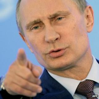 Russia's President Vladimir Putin gestures during a press conference at the end of the G20 summit in Saint Petersburg, Russia, on 6 September 2013