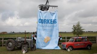 A giant crisp packet is suspended from a machine