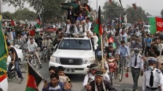 Afghans welcome their national football team a day after they beat India 2-0 in the South Asian Football Federation Championship in Kabul, Afghanistan, on 12 September 2013.