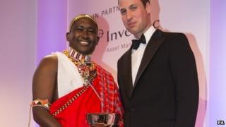The Duke of Cambridge presents the first Tusk Conservation Award to Tom Lalampaa at the inaugural Tusk Conservation Awards at the Royal Society, London.