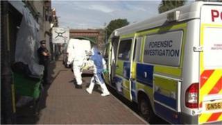 Forensic teams at scene
