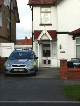 Police car at the home of Carole Wall
