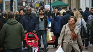 A busy street in London with people of several different ethnicities