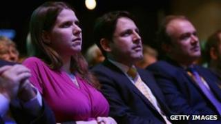 Jo Swinson sitting with Ed Davey at the Lib Dem conference