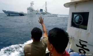 Undated file photo of a South Korean waving to a Japanese patrol boat in the Sea of Japan