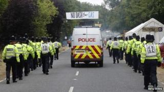 Police walk through protest camp at Balcombe