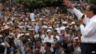 Leader of the opposition Cambodia National Rescue Party (CNRP) Sam Rainsy (R) speaks to supporters during a demonstration at the Democracy Park in Phnom Penh on 17 September 2013