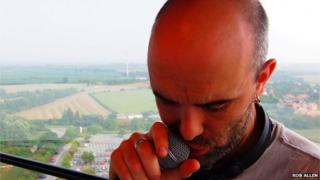 Cian Ciaran holding a microphone
