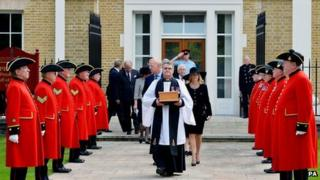 The Reverend Richard Whittington carries a casket containing Baroness Thatcher's ashes