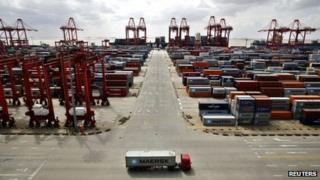 File photo: A container truck drives past the container area at the Yangshan Deep Water Port, part of the newly announced Shanghai Free Trade Zone, south of Shanghai, 26 September 2013