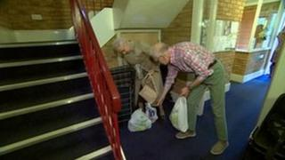 Residents help other with the shopping