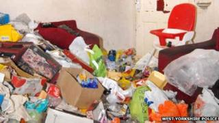 The rubbish-strewn living room in Amanda Hutton's house