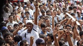 Andhra Pradesh government employee opponents of the creation of a separate state of Telangana carved out from the existing Andhra Pradesh state raise slogans during a meeting in Hyderabad, India, Saturday, Sept. 7, 2013.