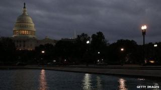 The US Capitol is lit under dark clouds on the morning of October 7.