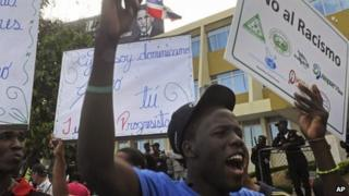 Demonstrators of Haitian descent protest outside the Constitutional Court in Santo Domingo, Dominican Republic on 2 October, 2013