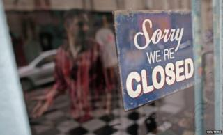 "Man walks past ""sorry we're closed"" sign in Paris"