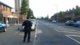 A police officer at the scene of the alert on North Queen Street