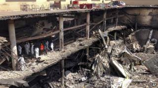 Forensics investigators work next to the collapsed upper car park at the Westgate shopping centre in Nairobi