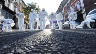 Forensic officers search scene of murder