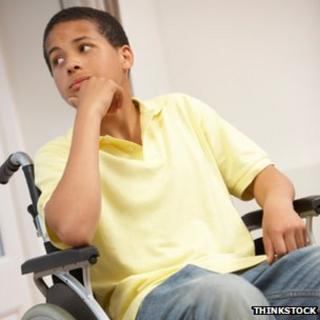 Teenage boy in wheelchair