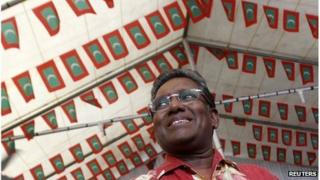 Mohamed Waheed smiles during a political meeting with his supporters in Male 6 September