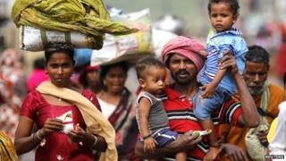 Some families have started returning to their cyclone-hit homes in Orissa