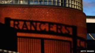 The shadow of the gates at Ibrox