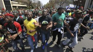Miners from Marikana, their families and supporters march to the Union Buildings in Pretoria, to protest against the government's lack of funding for the Marikana commission of inquiry (12 September 2013)