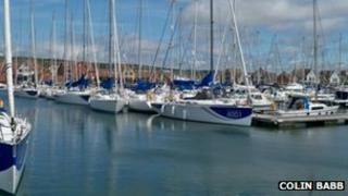 A fleet of yachts moored in Port Solent used for corporate events and sailing instruction by Sunsail