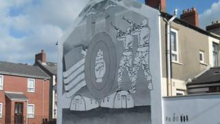 Outline of mural on gable wall
