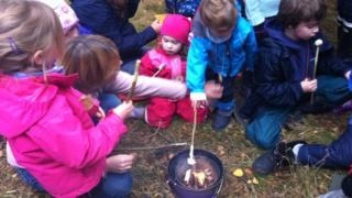 Children toasting marshmallows