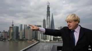 London Mayor Boris Johnson views the Shanghai skyline from The Bund as he arrives in the Chinese city for the second part of a week long visit to China to promote trade between the far east and London, 16 October 2013