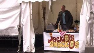 Chris Jackson running his fake food stall - Jacko's Snackos