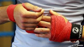 Boxer's hands being wrapped