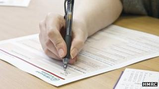 Hand filling out tax return