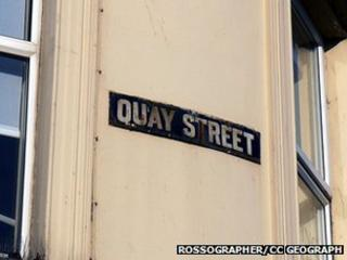 Old enamel street sign on a building at the corner of Quay Street, Bangor