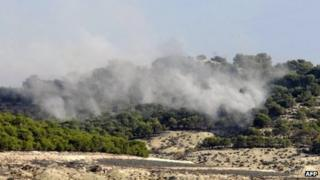 Smoke billows after the operation by Tunisian forces in the Mount Taouyer area. Photo: 19 October 2013