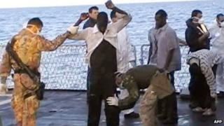 Italian navy video grab on 13 October 2013 shows immigrants frisked by crew members of a ship after being rescued from the sea off the Italian island of Lampedusa