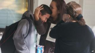 A Sparks Middle School student cries after being released from Agnes Risley Elementary School, where some students were evacuated to after a shooting in Sparks, Nevada 21 October 2013