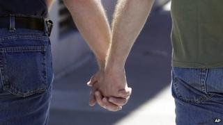 File image of two men holding hands
