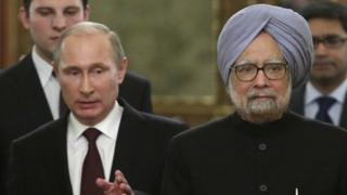 Russia's President Vladimir Putin (L) speaks with India's Prime Minister Manmohan Singh during their meeting in the Kremlin in Moscow, on October 21, 2013.