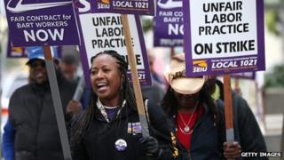 Striking Bart staff members picket in front of Lake Merritt station in Oakland