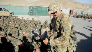 Australian instructor teaching Afghan recruits (pic: David Loyn)