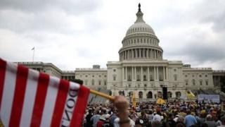 Tea Party activists rally at the US Capitol on June 17